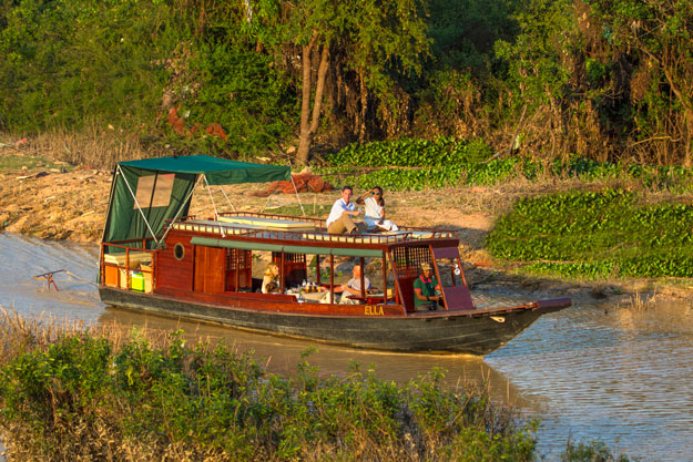 Cambodia Luxury Travel | Ker Downey | Private Boat on Tonle Sap Lake